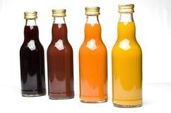 Jus de fruit dans des bouteilles Photo libre de droits