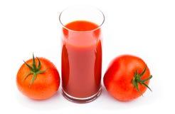 Jus de tomates d'isolement sur le blanc sur le blanc Images stock