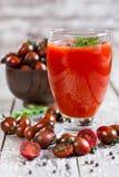 Jus de tomates et tomate-cerise Photos stock