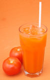 Jus de tomates sur le fond Photo stock