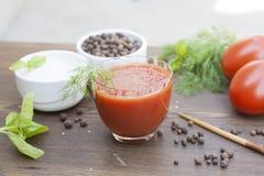 Jus et tomates de tomates Photo stock