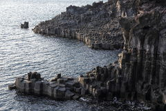 Jusangjeolli Cliff. The Jusangjeolli Cliff is a spectacular volcanic rock formation at the southern coast of Jeju Island, South Korea Royalty Free Stock Photos