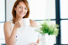 Just another day in my office. Young attractive businesswoman in office Royalty Free Stock Images