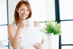 Just another day in my office. Young attractive businesswoman in office Royalty Free Stock Image