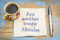 Just another magic Monday. Handwriting on a napkin with a cup of coffee stock image
