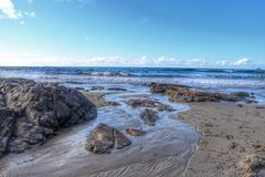 Just As The Tide Was Flowing. Beautiful Sennen Beach in the county of Cornwall, UK Stock Photography
