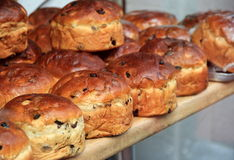 Just baked scones on wood shelf. Just baked, golden brown, raisin scones on wood shelf stock image