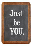 Just be you advice. On an isolated vintage slate blackboard Stock Image