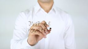 Just be Yourself, Man Writing on Glass. High quality royalty free stock photography