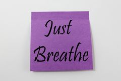 Just Breathe. Post-it note reminder to 'just breathe Royalty Free Stock Photo