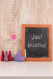 Just breathe!. Chalkboard with the words Just breathe, wellness and health care concept Stock Images