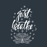 Just breathe. Inspirational quote about freedom. Modern calligraphy phrase with hand drawn ornamental lotus flower. Simple vector lettering for print and Stock Image