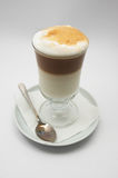 Just brewed coffee frappe. Just brewed glass mug of coffee frappe with crisp foam Royalty Free Stock Images