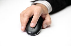 Just a click away. Men Hand on PC Mouse Close-up royalty free stock photos