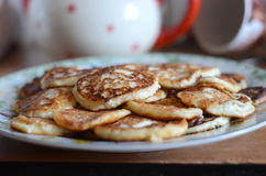 Just cooked pancakes. Freshly cooked hot delicious pancakes on the plate royalty free stock photo
