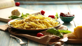 Just cooked Pappardelle italian cuisine dish on the rustic table stock footage