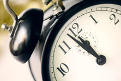 Just before deadline. Retro alarm clock close up Royalty Free Stock Images