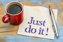 Just do it motivational advice on napkin. Just do it motivational advice or reminder on napkin with a cup of coffee. Motivation concept Royalty Free Stock Photos
