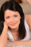 Just doing nothing. Close-up of beautiful young woman lying on t Royalty Free Stock Photography