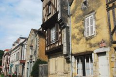 France- The Charming Medieval Village of Noyers-du-Serein. Just down the street from the commerical center of this quaint village lies remnants of a more Stock Images