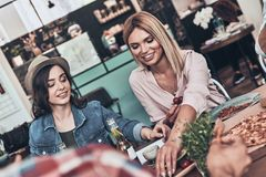Just enjoying meal and company. stock image