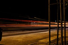 Just a few cars at night stock photography