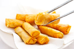 Just finished fried springrolls with chopsticks Stock Images