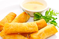 Just finished fried springrolls sweet plum sauce Royalty Free Stock Photo