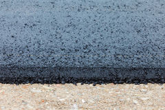 Just finished layer of new tarmac during road construction Stock Photography