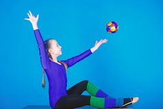 Just flying. Gymnastics. Happy child sportsman with ball. Sport and health. Fitness diet. Energy. Acrobatics gym workout. Of teen girl. success. Childhood stock photo