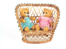 Just Friends. A male and female teddy bear in a wicker love seat, over white Royalty Free Stock Image