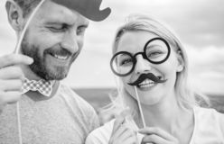 Just for fun. Humor and laugh concept. Couple posing with party props sky background. Photo booth props. Man with beard stock photos