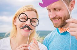 Just for fun. Humor and laugh concept. Couple posing with party props sky background. Photo booth props. Man with beard royalty free stock images