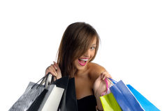 Just got back from shopping. Young woman screaming out of joy with shopping bags isolated on white Royalty Free Stock Photo