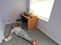 Just having a break... Man lying on carpet for a rest while working at home stock photography