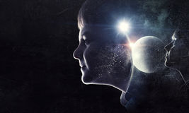 Just imagine how big this world . Mixed media. Exposure image of dreaming kid boy and girl and our world Royalty Free Stock Photography
