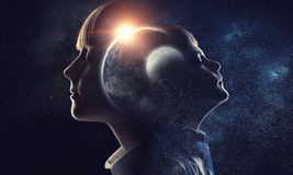 Just imagine how big this world . Mixed media. Exposure image of dreaming kid boy and girl and our world Royalty Free Stock Image