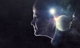 Just imagine how big this world . Mixed media. Exposure image of dreaming kid boy and girl and our world Stock Images