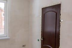 Just installed door in door opening filled with foam Stock Photo