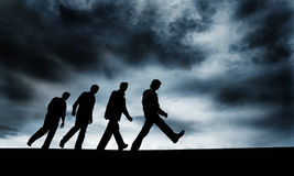 Just keep going. Walking group of people under the sky Royalty Free Stock Image