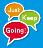 Just Keep Going. Concept on blue background Stock Photo