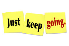 Just Keep Going Determination Persistence WInning Attitude. The words and saying Just Keep Going written on sticky notes to illustrate determination, tenacity Royalty Free Stock Images