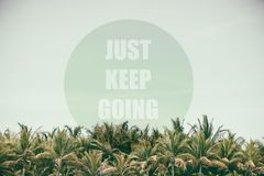 Just Keep Going. text of the coconut trees. Inspiring Creative Motivation Royalty Free Stock Images