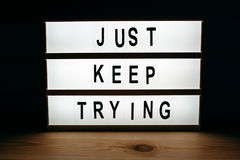 Just keep trying. Motivational message on lightbox Royalty Free Stock Photos