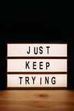 Just keep trying. Motivational message on lightbox Royalty Free Stock Photo