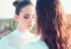 Just letting my hair go. Cute girls with new hairstyles. Teenage girls with natural wavy hairstyle and hair bun. Hair royalty free stock images