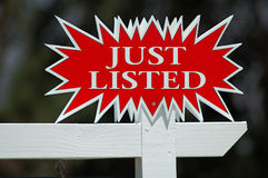 Just Listed Real Estate Sign. Isolated Royalty Free Stock Photography