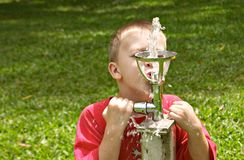 Just a little more. Thirsty young boy not quite tall enough Royalty Free Stock Images