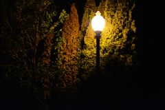 Just a lonely light in the night. Jusst a lonely light in the night shinning through the dark stock photography
