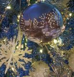 Blue Christmas tree with white ornaments. Just looking at this blue and white Christmas tree will put you in the holiday spirit Royalty Free Stock Photography